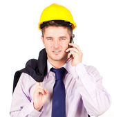 Construction worker talking on the phone — Stock Photo