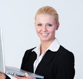 Happy Businesswoman holding a laptop — Stock Photo