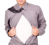 Young attractive man pulling at his t-shirt — Stock Photo