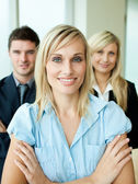Business headed by a woman with folded arms — Stock Photo