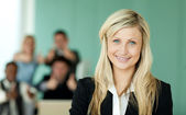 Businesswoman in front of her team in an office — Photo
