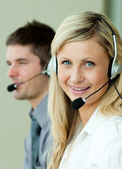 Two business working with headsets — Stock Photo