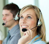 Two businesspeople with headsets — Stock Photo