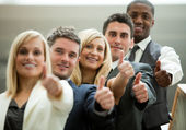 Businesspeople with fists in front — Stock Photo