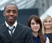 Afro-American businessman in front of his colleages — Stock Photo