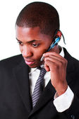 Businessman wearing an earpiece — Stock Photo