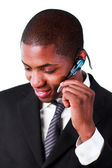 Businessman using an bluetooth earpiece — Stock Photo