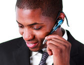 Close-up of an businessman using an bluetooth earpiece — Stock Photo