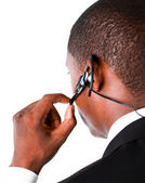Close-up of an Businessman showing his earpiece — Stock Photo