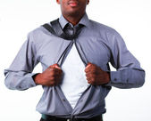 Businessman showing tshirt under his suit — Stock Photo