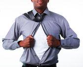 Businessman showing tshirt under his suit — Stock Photo