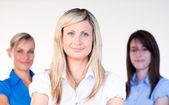Three beautiful businesswomen smiling at the camera — Foto de Stock