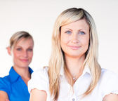 Portrait of a blonde businesswoman with her colleague — Stock Photo