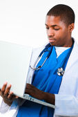 Portrait of an young African doctor working on a laptop — Stock Photo
