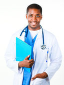 Happy doctor holding a clipboard — Stock Photo