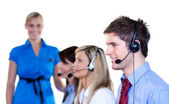 Businesspeople talking with headset — Stock Photo