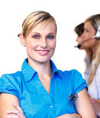 Beautiful businesswoman in a call center — Stock Photo