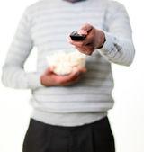 Man holding popcorn — Stock Photo