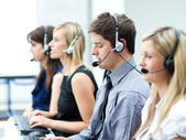 Attractive young man working in a call center — Stok fotoğraf