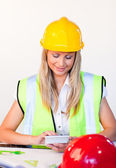 Blonde woman working with hard hat on — Stock Photo