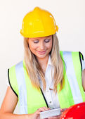 Worker with hard hat looking at drawing — Stock Photo