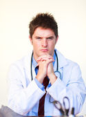 Serious young doctor looking at the camera — Стоковое фото