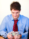 Businessman counting money — Stock Photo