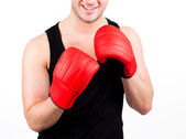 Young man wearing boxing gloves — Stock Photo