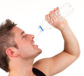 Man drinking water after workout — Stock Photo