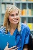 Blond doctor at work — Stock Photo