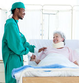 A surgeon caring for a patient — Stock Photo