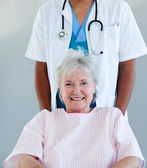 Smiling senior patient sitting on a wheelchair — Stock Photo