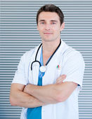 Charismatic male doctor looking at the camera — Stock Photo