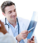 Portrait of a charming male doctor showing the results to his pa — Stock Photo