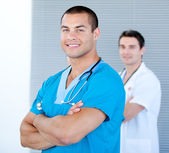 Handsome male doctor looking at the camera — Stock Photo