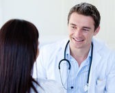 Portrait of a male doctor talking with his patient — Stock Photo