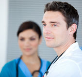 Charismatic male doctor looking at the window — Stock Photo