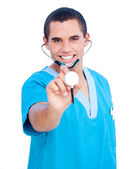 Hispanic male doctor wearing blue uniform holding a stethoscope — Stock Photo