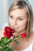 Portrait of a cute woman holding roses — Stock Photo