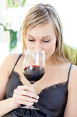 Beautiful woman drinking red wine — Stock Photo