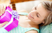 Happy woman holding a present — Stock Photo