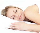 Radiant woman sleeping on her bed — Stock Photo
