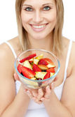 Happy woman holding a fruit salad — Stock Photo