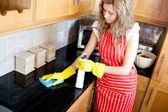 Charming woman doing housework — Stock Photo