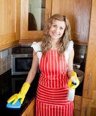 Cherful woman doing housework — Stock Photo