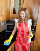 Smiling woman doing housework — Stock Photo