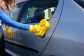 Close-up of a woman cleaning her car — Stock Photo