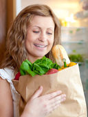Charming woman holding a grocery bag — Stock Photo