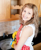 Positive woman doing the dishes — Stock Photo