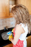 Caucasian woman doing the dishes — Stock Photo
